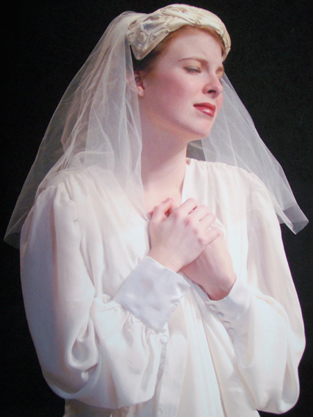 Breeny in wedding cap and lingerie from Sky Girls, 1940s costume design by Katharine Tarkulich