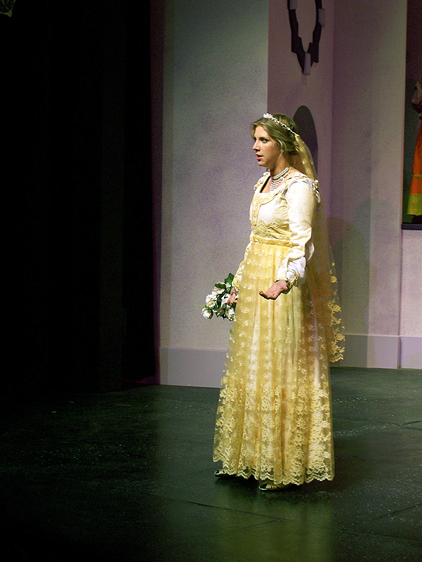 Kate in her wedding dress in Shakespeare's The Taming of the Shrew, costume design by Katharine Tarkulich