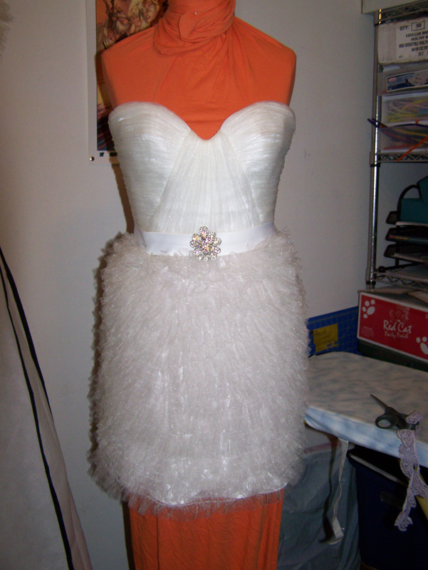 Bridal ballgown turned into a miniskirt wedding dress by Katharine Tarkulich