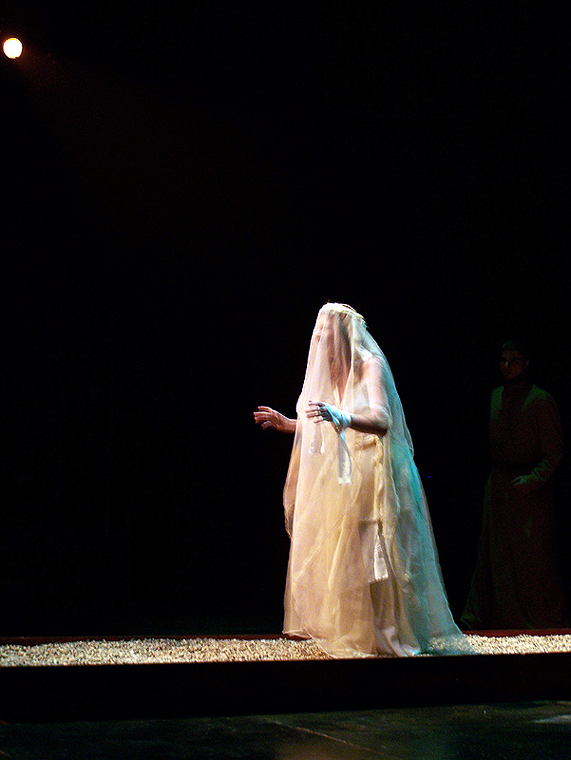 Cassandra as bride with veil in The Women of Troy costume design by Katharine Tarkulich