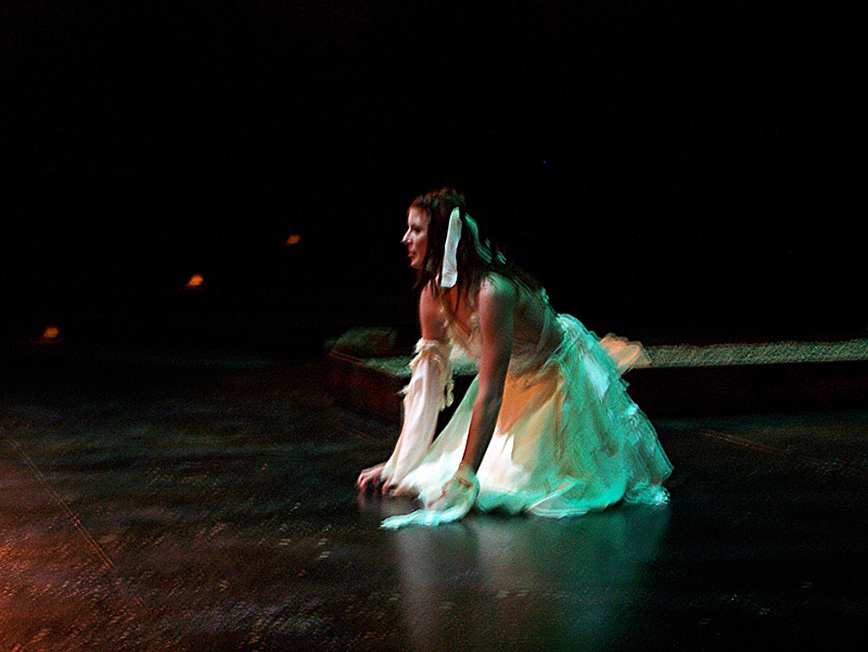 Cassandra mourns in The Women of Troy costume design by Katharine Tarkulich