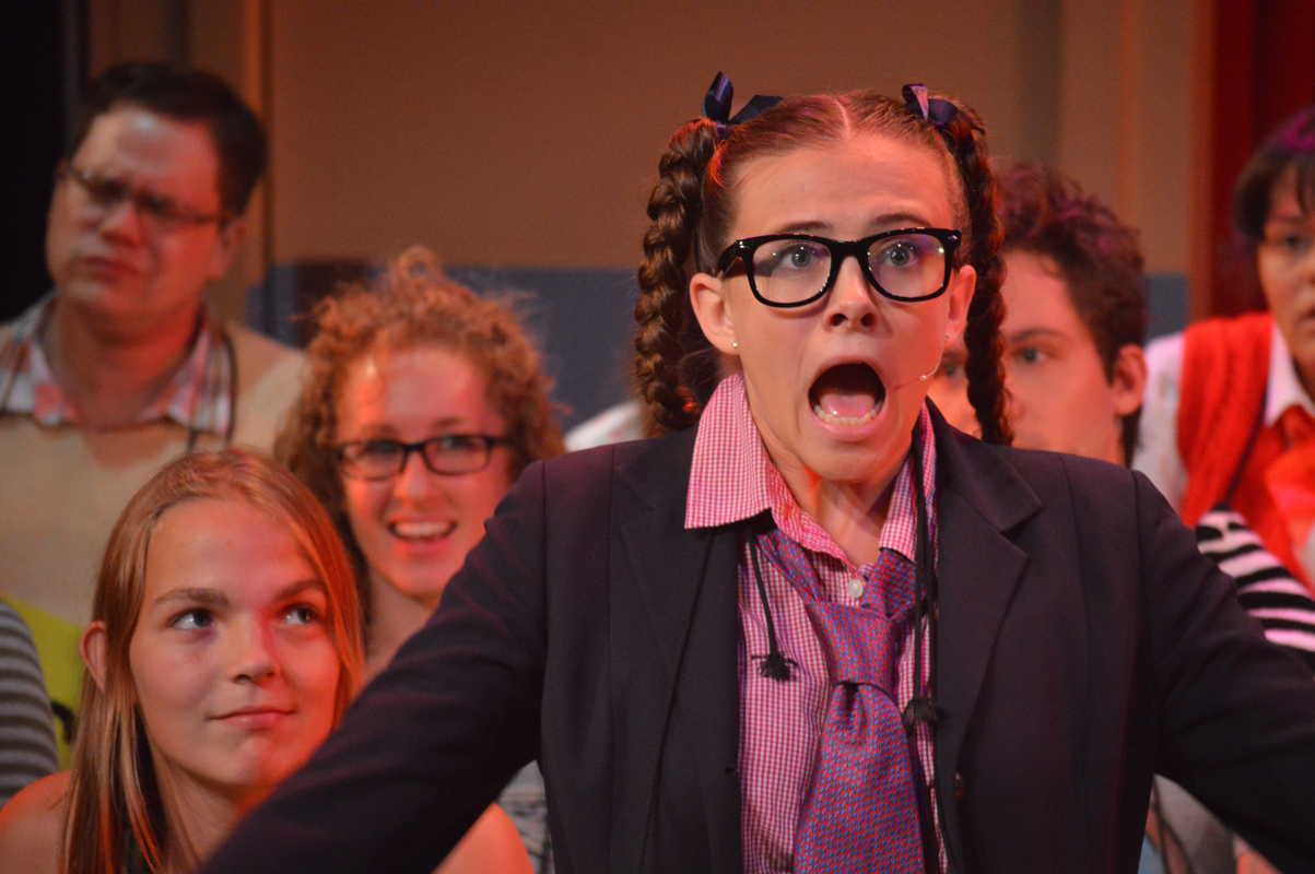 "Logainne ""Schwarzy"" SchwartzandGrubenierre nerdy in glasses and prep school uniform in The 25th Annual Putnam County Spelling Bee, costume design by Katharine Tarkulich"