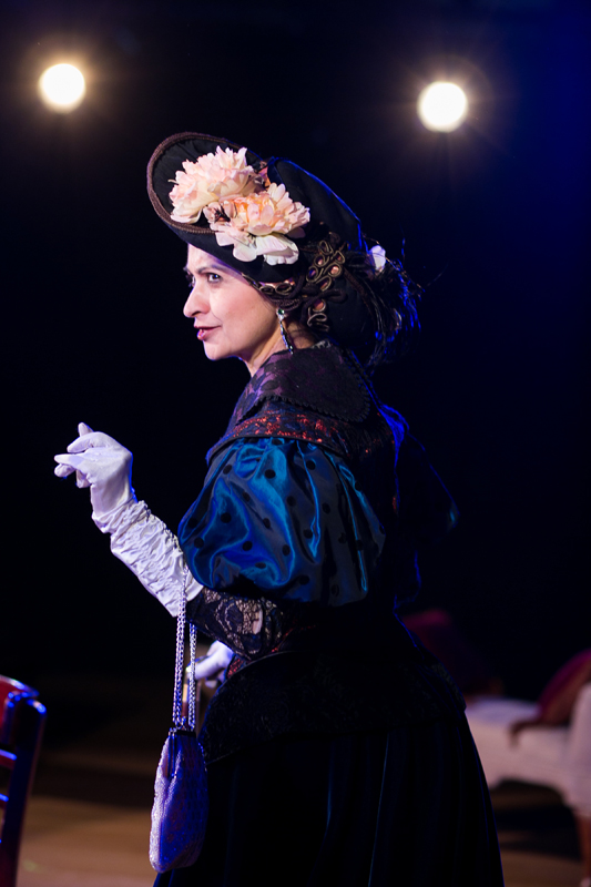 Lady Bracknell with large black hat with peach flowers in The Importance of Being Earnest, costumes designed by Katharine Tarkulich