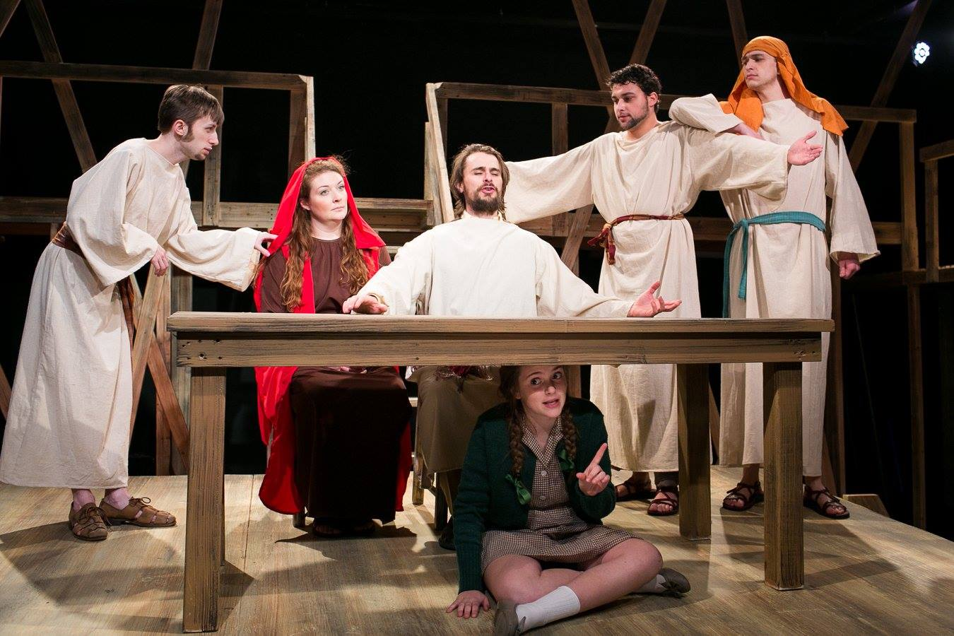Eric as Jesus with Violet, Mary 2 (Mary Magdalene) and ensemble from Act 2 of Sarah Ruhl's Passion Play costume design by Katharine Tarkulich