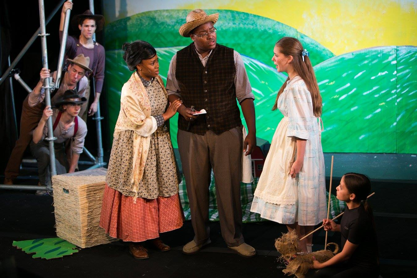 Farmhands, Aunt Em, Uncle Henry, Dorothy, and Toto in the Wizard of Oz costume design by Katharine Tarkulich