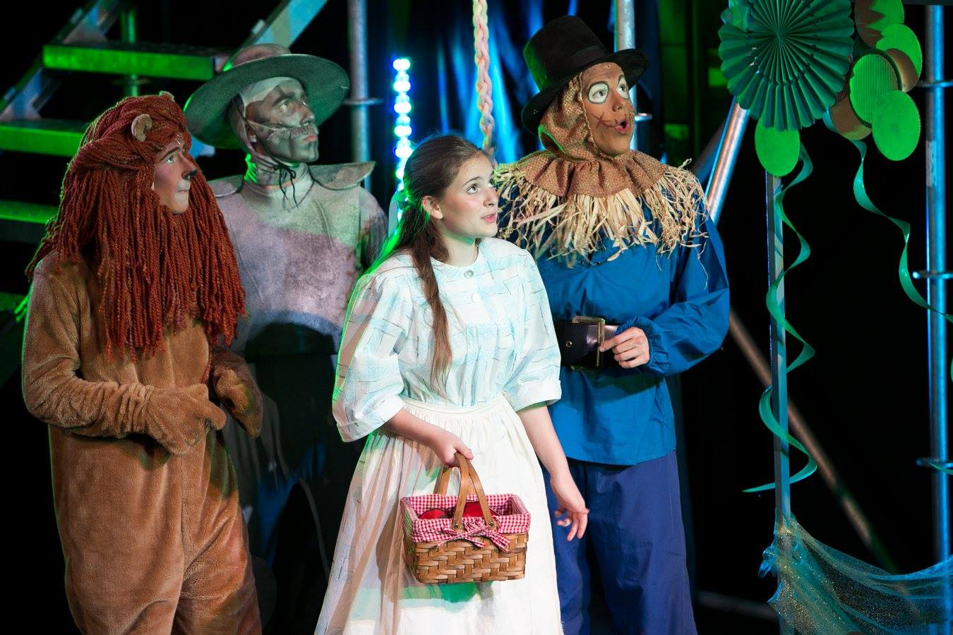 Lion, Tin Man, Dorothy, and Scarecrow in The Wizard of Oz costume design by Katharine Tarkulich