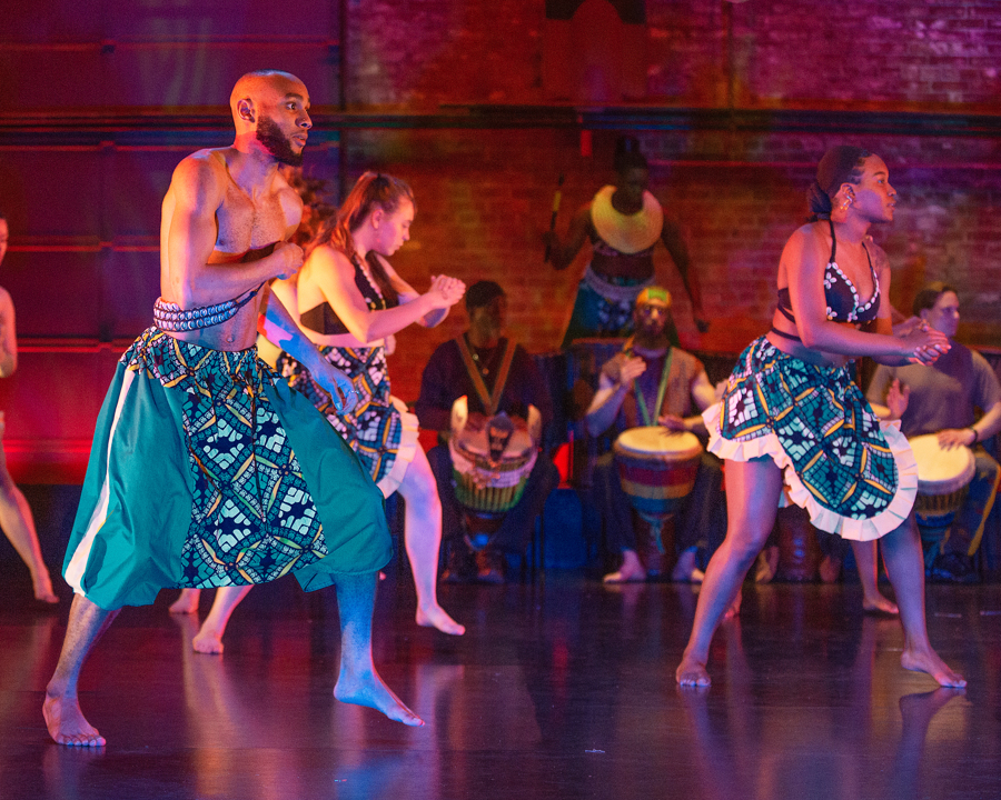 Konkoba African dance - lapas and shokotos graphic print skirt and short pants for the Sankofa dance concert at the College at Brockport, costume design and built by Katharine Tarkulich